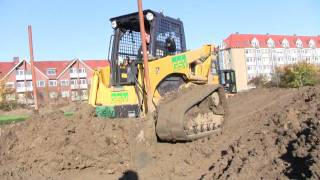 Komatsu CK30 Skid-steer With Flip Dozer Blade Pushing Clay