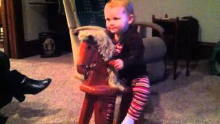 Alexis Loves Her New Rocking Horse