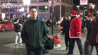 DRUNK GUY PUNCHES SANTA CLAUSE IN THE FACE