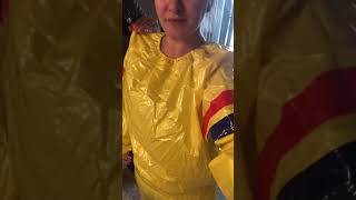 Girl Inflating Her Plastic Suit