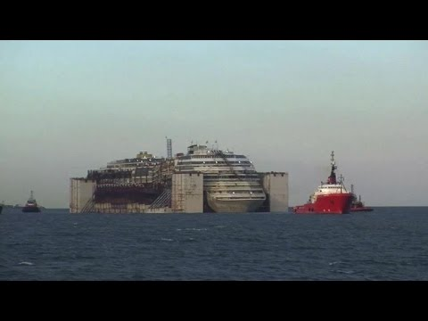 Italy's wrecked cruise ship prepares to dock in Genoa