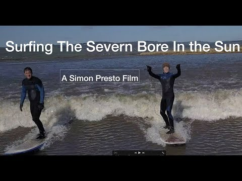 Surfing The Severn Bore In Sun