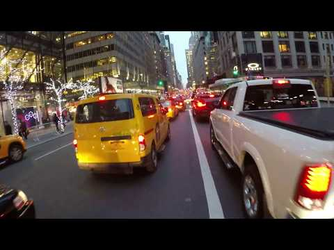 NYC Cycling 5th Avenue from 59th Street to Washington Square Park during the Holidays 2017 (Raw)