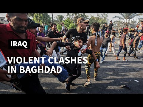 Injured Iraqi protesters evacuated after clashes in Baghdad | AFP