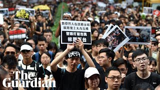 Hundreds of thousands take to streets in renewed Hong Kong protests thumbnail