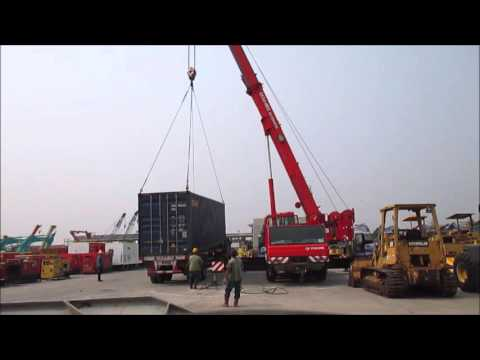 Jakarta Auctions - unloading cargo containers using the Tadano ATF70 All Terrain crane