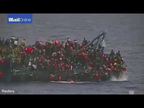 The moment the carrier 550 refugees aboard capsized in the Mediterranean Sea