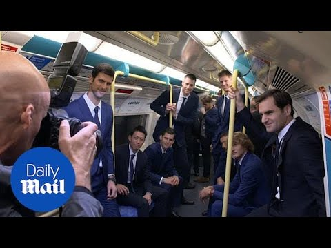 Roger Federer and Novak Djokovic enjoy a ride on the tube