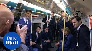 Roger Federer and Novak Djokovic enjoy a ride on the tube
