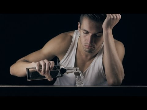 Depressed Man Drinking Vodka In a Dark Room | Stock Footage