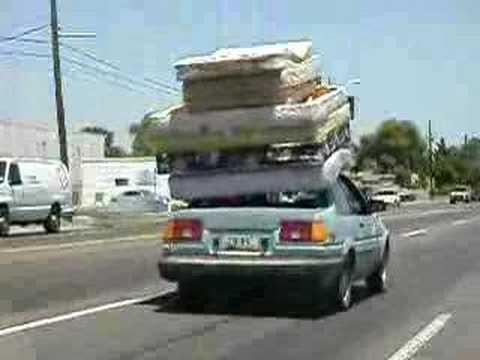 7 mattresses strapped to roof of car - YouTube