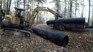 Installing culvert pipe on new driveway