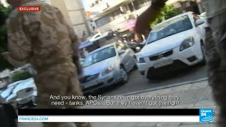 EXCLUSIVE - Report alongside Russian soldiers in Syria
