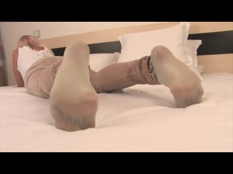 streching her nylon soles on bed