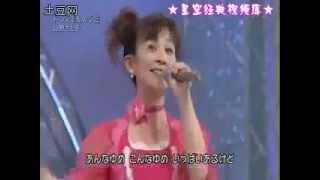 Satoko Yamano   (山野 さと子) performing the Doraemon (ドラえもん) ...