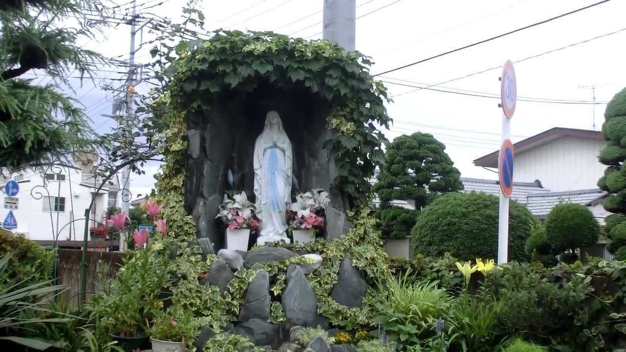flowers and plants in the grotto of the Virgin Mary