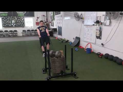 Elite football athlete, Logan ➡ reverse sled drag.....with a lot of weight 🔨