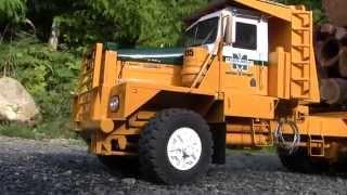 Kenworth 850 Logging truck hauling a heavy load of cedar