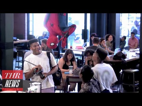Spider-Man Grabs Coffee, Scares the Webbing Out of Cafe Customers | THR News