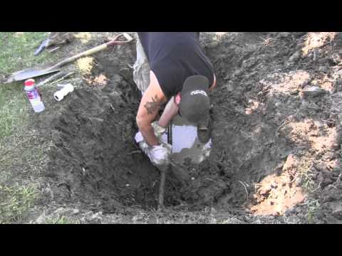 Repairing a main water line with a compression coupler