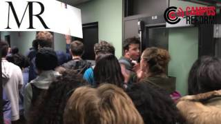 Anti-Trump protesters storm library at the University of Michigan