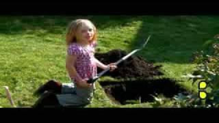 little girl buries goldfish