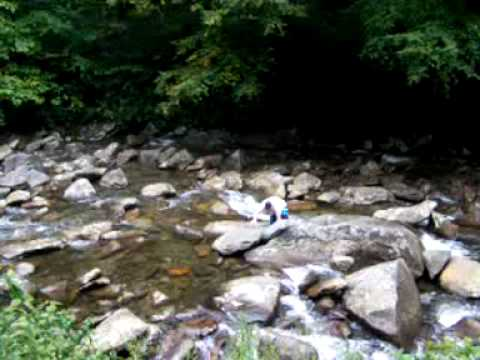 Erik drinking from a mountain stream