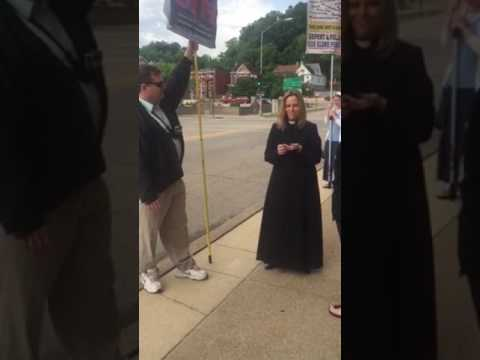 Protesters outside First Congregational Church Dubuque, Iowa with Pastor Lillian Daniel