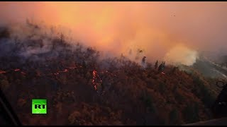 Aerial footage: California National Guard battles deadly wildfires