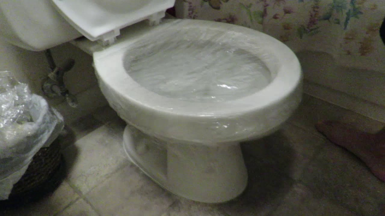 Unclog toilet with Saran Wrap? - YouTube