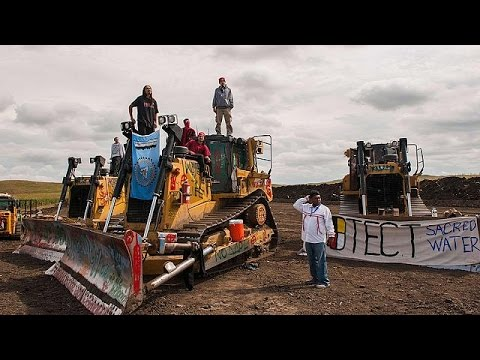 Partial halt to North Dakota oil pipeline opposed by Native Americans