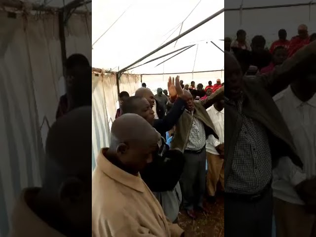 Brother Maurice Leading a Thank You Prayer for Widow Tailor Training Funds WFF Moi's Bridge Kenya