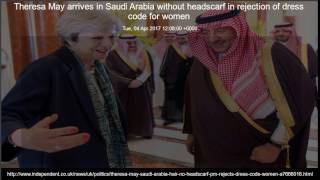 Theresa May arrives in Saudi Arabia without headscarf in rejection of dress code for women