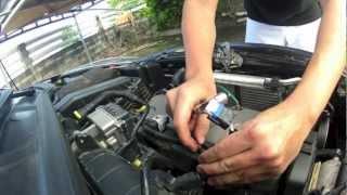 Peugeot 206+: Dépose de la bobine d'allumage