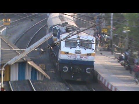 Smoking WDP-4D hauling 24 coaches Saraighat SF honks past Bally