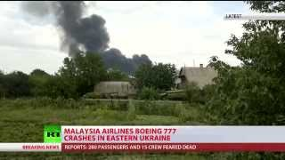 Malaysia MH17 crash site witness: bodies, debris, passports scattered