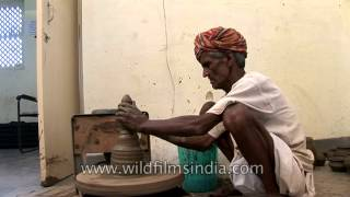 An old potter at work in Uttar Pradesh, India