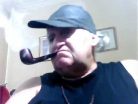 "Smoker, of Danske, Club, Straight, Pipe Tobaccos, with Black Hat; and Music of Cinema: "" Lara """