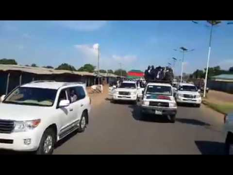 kiir tours juba in an open car