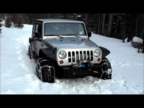 Supercharged Jeep Rubicon Unlimited testing snow chains.