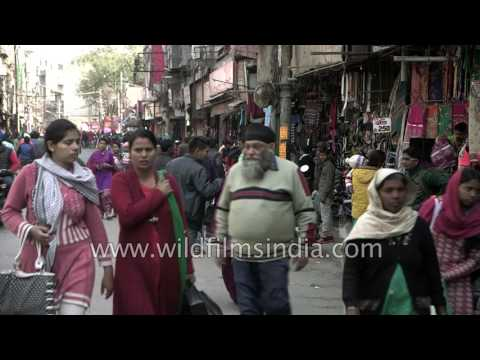 Ludhiana garment shop and marketplace with mixed pedestrian and vehicular traffic