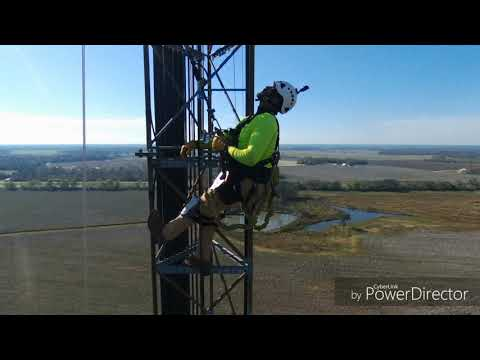 Tower Technician Climbing To Upgrade An At&t Network.