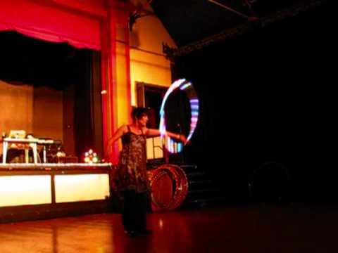 Sharna Rose performing at the Spirit Hoop Cake UK premiere of The Hooping Life