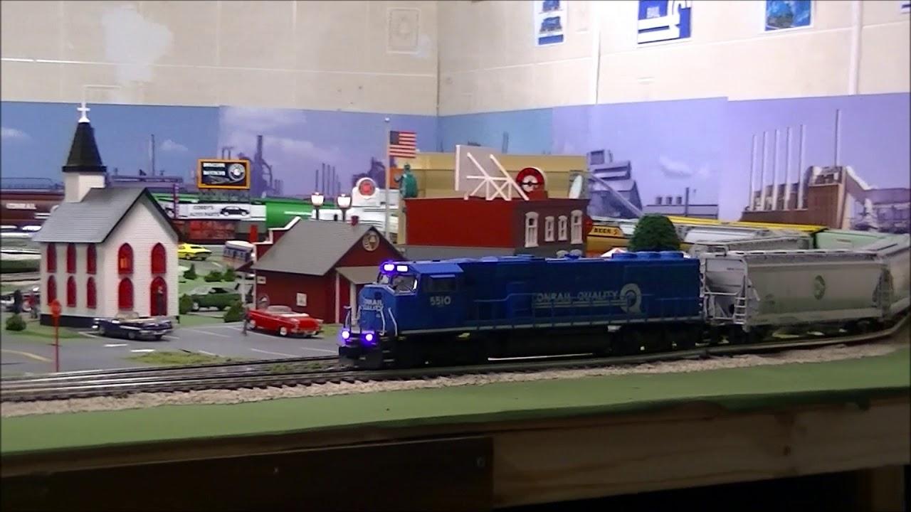 Conahey Rail A SD60M Heads a Cargill Foods Train - O Gauge
