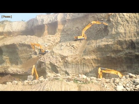 4 Hyundai Excavator with Breaker and Bucket Working on the cliff digging sands