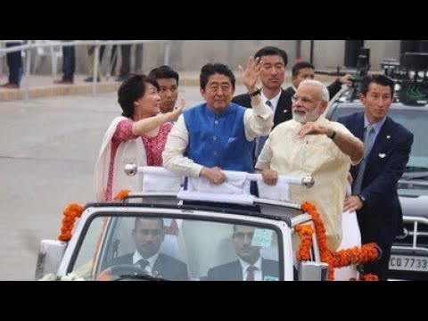 JAPANESE MINISTER SHINZO ABE WITH PM MODI IN RALLY IN INDIAN ROAD.