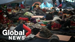 Caravan migrants await asylum hearings at U.S. border