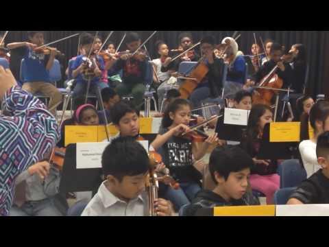 Saurya playing violin in Hutchison Elementary school string concert