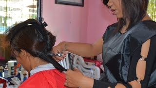Woman forced haircut