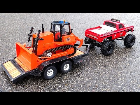 "RC ADVENTURES - ""BEAST"" Monster Truck pulls Mini Dozer on Trailer - Heavy Snow Removal"